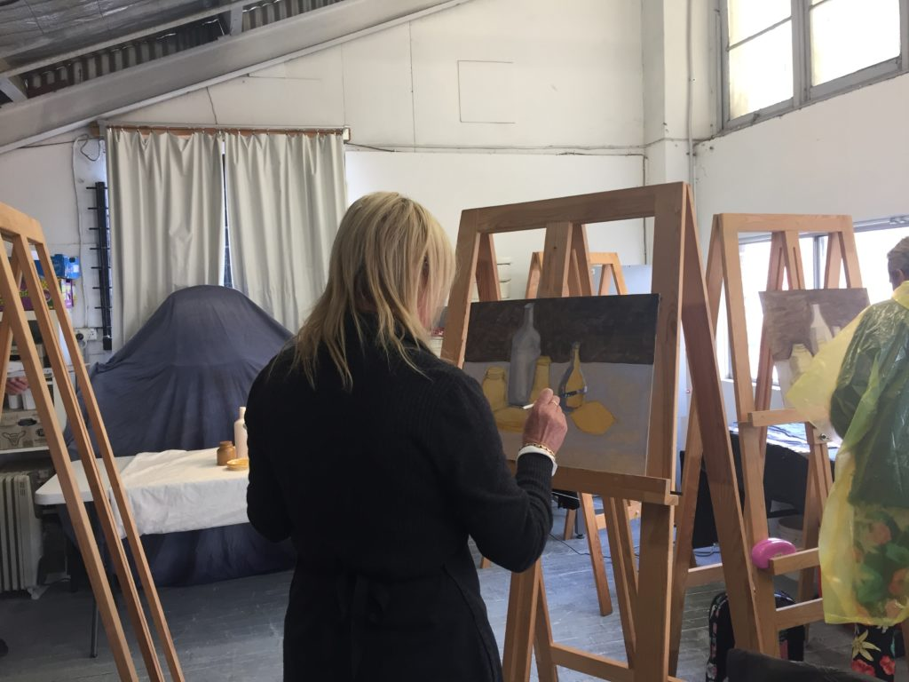 Learn the fundamentals of painting and drawing. This is a picture of a student at the recent painting fundamentals workshop.