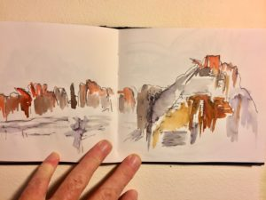 ink and watercolour sketch of a landscape by Ochre Lawson